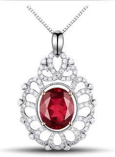 Oval Ruby Pendant in 14Kt White Gold.