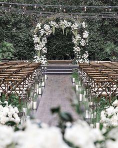 The bride's big-day look stole the show. #Wedding #WeddingCake #WeddingIdeas #WeddingInspiration #BlackandWhite #ClassicWedding #Wedding #LosAngeles | Martha Stewart Weddings - One Couple Planned a Stylish Black-and-White Wedding in Los Angeles