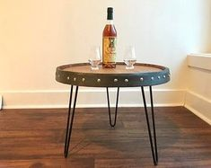 Barrel table | Etsy #barreltable,#reclaimedwoodcoffeetable,#winebarreltable,#whiskeybarreltable,#barrelendtable,#whiskeybarrelcoffeetable,#coffeetable,#barrelfurniture, #winebarrel,#winebarreltable, #whiskeybarreltable,#reclaimedwood Bourbon Barrel, Bourbon Whiskey, Used Whiskey Barrels, Wine Barrel Table, Whiskey Distillery, Minwax Stain, Patina Color, Wine And Beer, Liquor Cabinet