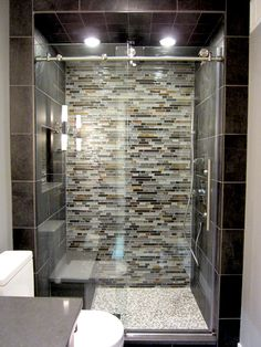 Alair Homes | Regina | Bathroom - Custom shower, floating cabinet with under cabinet lighting, heated tile floor, and quartz countertop.