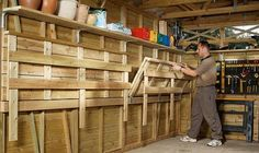 Here's a versatile garage workbench that folds up into the walls for extra space.