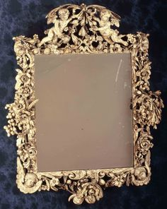 A Charles II carved limewood mirror in the manner of Grinling Gibbons. http://www.ossowski.co.uk/stock/d/a-charles-ii-carved-limewood-mirror-in-the-manner-of-grinling-gibbons/106873