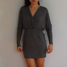 Heather gray mini dress with low v front Heather gray mini dress with low v front and keyhole detail in the back. Worn just a handful of times and in excellent condition. Purchased from LuLus. Dress has pockets and is body con. No trades sorry! Lulu's Dresses Mini