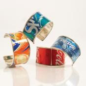 These fun bracelets are made from repurposed tin soda cans and makes an amazing pop art statement! Show your love for the Earth with this great fashion accessory.