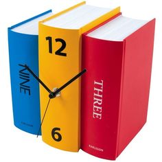 Read time like a book in the shape of the Book Table Clock from Karlsson. An analogue clock which features three books - one with the numbers 12 and 6, one wit…
