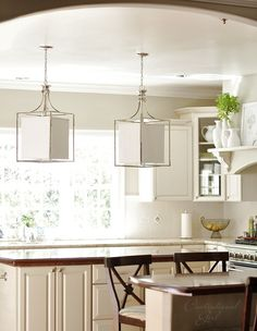 Framed Polished Nickel & Linen Shade Lanterns--I have a bias for pendant-like lights above the kitchen island.