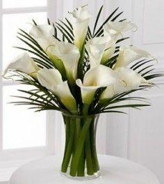 Reception floral arrangement idea, orange callas and palm fronds