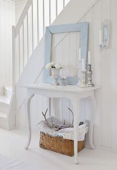 All-white hallway with a pale blue frame decor piece! Simple, clean with shabby chic warm!