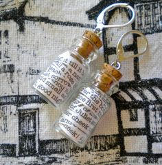 """Romeo and Juliet in a Jar Earrings by GrievousAngelDesigns, $16.00  Each tiny vial contains seven quotes from Shakespeare's timeless, beautiful, tragic story of young """"star-cross'd lovers"""" - (fourteen different quotes total!)"""