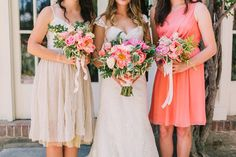 bride and bridesmaids - photo by Lillywhite Photography http://ruffledblog.com/wearing-her-sisters-wedding-dress