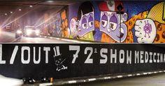 Painel de grafite é coberto com divulgação de festa universitária.