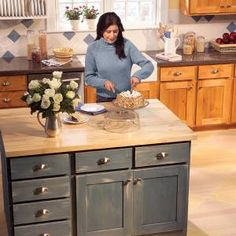 ISLAND!  DRAWERS!  Squeeze more usable space out of your kitchen base cabinets by installing rollout drawers. How-to photos and plans show how to make standard and wastebasket rollouts.