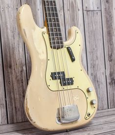 Olympic White P Bass from 1963 with that lovely vintage patina giving it an awesome feel. Previous owner purchased this guitar in the late and used it Fender Bass Guitar, Fender Electric Guitar, Fender Guitars, Guitar Chords, Acoustic Guitar, Vintage Bass, Fender Vintage, Bass Guitar Lessons, Guitar Tips