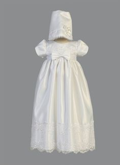 Girls Baptism-Christening Gown Style CATHY - WHITE Embroidered Satin and Lace Gown  Gorgeous short sleeved satin gown with embroidered lace accents and front bow. The great part about this ensemble is that you can always wear the dress without the bonnet as this would make a gorgeous gown for a young child in a wedding also. Outfit comes with everything that is pictured.  http://www.flowergirldressforless.com/mm5/merchant.mvc?Screen=PROD&Product_Code=L_CATHY&Store_Code=Flower-Girl&..
