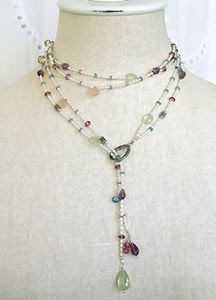 Here is a version of a lariat necklace that features gorgeous freshwater pearl bead strands sprinkled with multi-colored gemstone beads. An ...