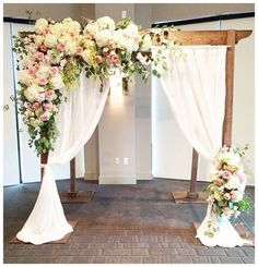 This is an example of the design for the florals on the pipe and drape for the ceremony. It's much heavier on floral in the corner of the structure, than the desired look, but gives us an inspiration to to start from.