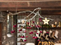 Spray paint, embroidery floss and dried cockscombs turn a basic branch into a stunning hanging centerpiece. (http://blog.hgtv.com/design/2013/11/22/make-a-holiday-branch-chandlier-hanging-centerpiece/?soc=pinterest-blogparty)