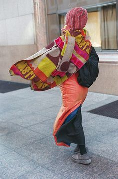 Credit: Bill Cunningham/The New York Times Monday, 10:55am: Wind Chill Minus 10 Degrees. Cunningham's photographs don't just celebrate the trend-setters. Here, a passerby swathed in layers against the cold is transformed into a fashion leader. Published in January 2000