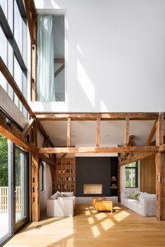 flooring porcelanato La Firme turns abandoned shed into Quebec home The Barn - White, light-filled. Quebec, Master Thesis, Mechanical Room, Open Family Room, White Oak Floors, Interior Windows, Shed Homes, Exposed Wood, Large Windows
