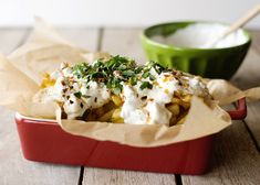 """Jack's Urban Fries ..""""Urban Fries are french fries topped with blue cheese dressing, hot chili oil, red pepper flakes, and lots of chopped parsley"""""""