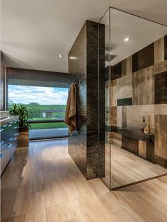 Love the shower behind the wall and the tiled woodplank-look wall.