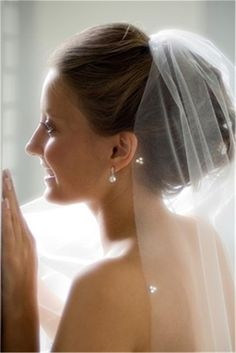 Sheer veil with rhinestone accent