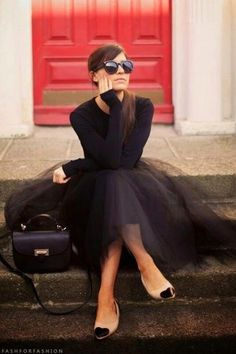 Women's' Black Sunglasses, Black Long Sleeve T-shirt, Black Tulle Full Skirt, Black Leather Satchel Bag, and Black and Tan Leather Ballerina Shoes
