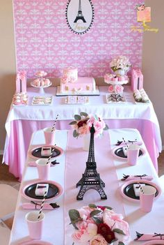 Eiffel Tower/Paris theme | CatchMyParty.com #paris #birthdayparty #cake #table #tablesetting #pink #eclair #french #macron