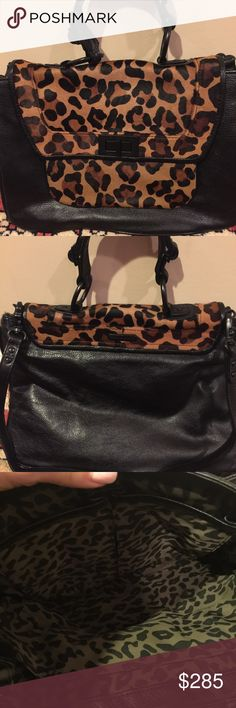 """Rebecca Minkoff Leopard Covet bag WORN ONCE! Gorgeous black pebbled leather bag with leopard print haircalf trim and a turnlock front closure. Patch pocket located under front flap. Top handle with 4"""" drop. Detachable shoulder strap with 13"""" drop. Interior has zip pocket and 3 slip/multifunction pockets. Original dust bag included. Rebecca Minkoff Bags Satchels"""