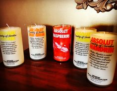 Fantastic way to reuse the Absolut bottles. Candles for the bar