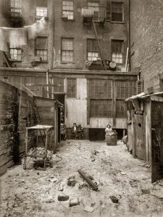 February 1912. Rear view of tenement, 134½ Thompson St., NYC. See the outhouses on the right of the pic, & the broken chicken coop (?) on the left, wash basins & baskets hanging outside windows. One young boy is reading.  My grandma, who grew up at 87 Thompson just a few buildings south of this address, was 4 when this pic was taken. Maybe that's why this is a fave pic of mine. Visit the Lower East Side Tenement Museum in NYC for a compelling view of life back then. @AmericourtPride