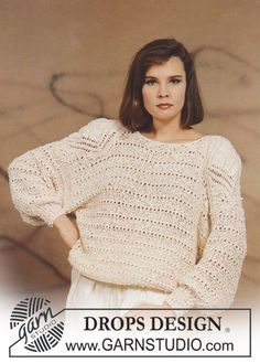 DROPS jumper in Erio with lace pattern in Zebrino. Size S – L.