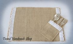 Burlap place mat, silverware pocket  for rustic wedding table decorations, or French, country weddings. $11.50, via Etsy.