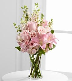 pink roses, spray roses, Oriental lilies, hydrangea and larkspur