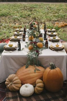 Autumn Tablescape: Bring the pumpkin patch to your fall wedding with this fantastic tablescape concept. Create a greenery runner and dot it with small pumpkins and then surround the end of the table with larger gourds.