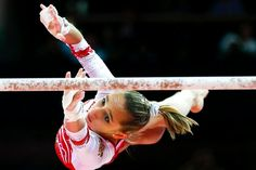 Russian gymnast Victoria Komova on the asymmetric bars during the women's gymnastics team final at the London 2012 Olympic Games on July 31, 2012.