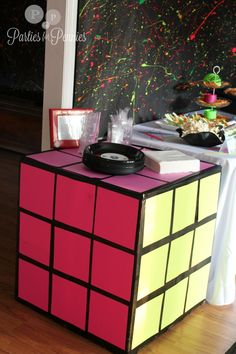 80s Party - rubik cube table, with posterboard and black electrical tape. I wish I would have seen this prior to Zach's party but still had to share. #80'sparty