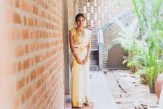 When it comes to South Indian Weddings, the beauty lies in their simplicity - the thoranams, the tharavaad style decor and the marigolds used sparingly. The bridesmodern blouse on a kasavu sari, a. South Indian Weddings, South Indian Bride, Indian Bridal, Kerala Bride, Telugu Brides, Hindu Bride, Long Braids, Before Us, Rustic Charm