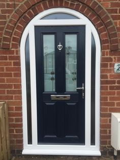 dark blue composite door in a white upvc arched frame. Installed by Windseal Double Glazing based in Coventry & Warwickshire Arched Front Door, Front Door Entryway, Victorian Front Doors, Porch Doors, Arched Doors, Exterior Front Doors, House Front Door, House Entrance, Front Porch