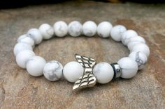 Check out this item in my Etsy shop https://www.etsy.com/listing/257893287/angel-wing-beaded-women-bracelet-womens