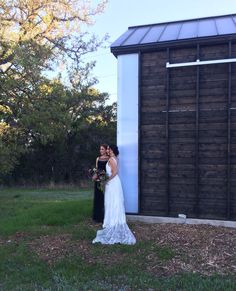 Bride and bridesmaid by the maintenance / garden shed