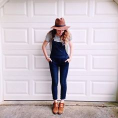 Dark denim overalls, striped tee, floppy fedora, ankle boots