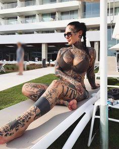 Girl with tattoos all over in a bikini