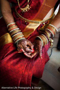 South Indian bride. Temple jewelry. Classic red bridal silk kanchipuram sari. Braid with fresh flowers. Tamil bride. Telugu bride. Kannada bride. Hindu bride. Malayalee bride. South Indian wedding.