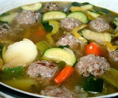 Slow cooker Mexican meatball soup.Delicious Mexican soup with meatballs vegetables and herbs cooked in slow cooker..