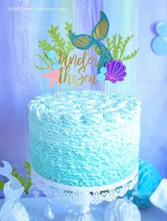 Learn how to decorate the most amazing mermaid birthday party! And you'll be excited at all the FREEBIES available to you and tons of mermaid party ideas and mermaid decor to DIY with exclusive mermaid printables.