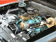 1965 Pontiac GTO 389 tripower. I know an old farmer whose buddy had one of these new in late-'64. Talk about power!