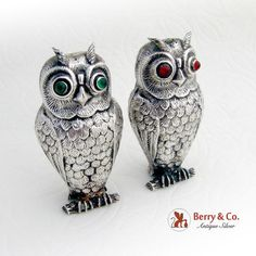 "Vintage set of salt and pepper shakers in shape of a nicely detailed owls with red and green eyes. One shaker is made of a Spanish 830 silver, the other one is marked ""Alpaca"" (alloy that imitates sterling silver). c. 1930."