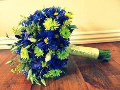 blue purple green wedding bouquet daisies