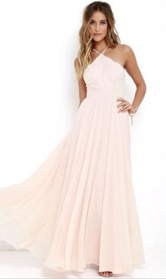 It was a light pink dress and had a x on the top